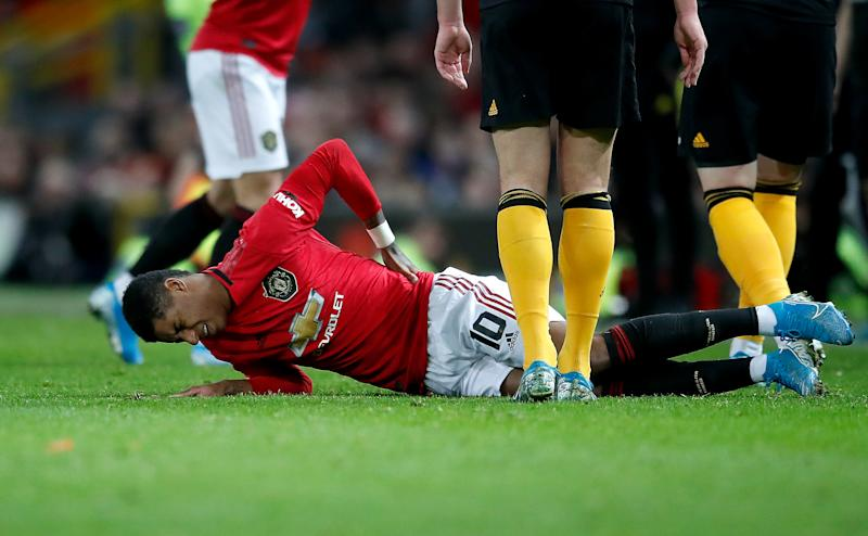 Manchester United's Marcus Rashford lies in pain after picking up a back injury during the FA Cup third round replay match at Old Trafford, Manchester. (Photo by Martin Rickett/PA Images via Getty Images)