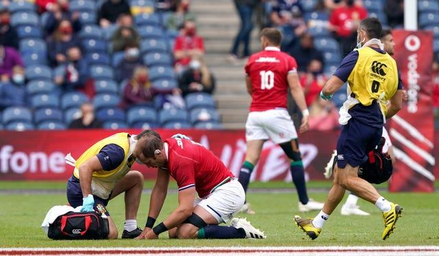 Alun Wyn Jones receives medical attention during the British and Irish Lions match against Japan. The injury ruled him out of the upcoming tour of South Africa