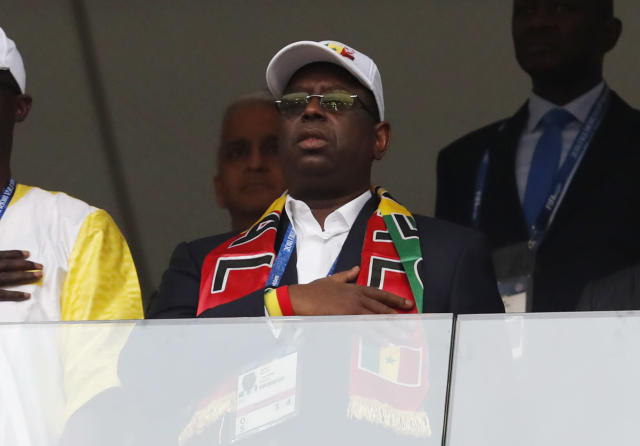 The President of Senegal Macky Sall listens to nation anthem prior the group H match between Poland and Senegal at the 2018 soccer World Cup in the Spartak Stadium in Moscow, Russia, Tuesday, June 19, 2018. (AP Photo/Darko Vojinovic)