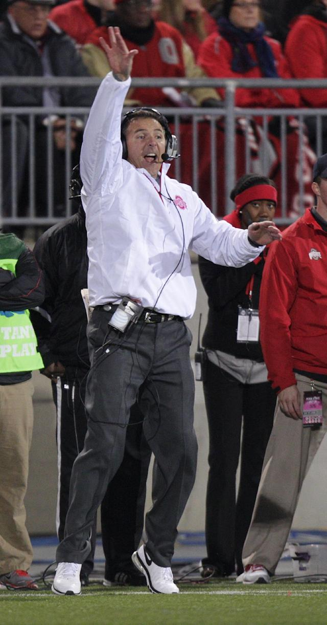 FILE - In this Oct. 26, 2013 file photo, Ohio State head coach Urban Meyer shouts instructions to his team against Penn State during an NCAA college football game in Columbus, Ohio. Meyer said he voted the No. 3 Buckeyes (9-0, 5-0 Big Ten) second on his USA Today coaches ballot, behind two-time defending champion Alabama but ahead of second-ranked Florida State. (AP Photo/Jay LaPrete, File)