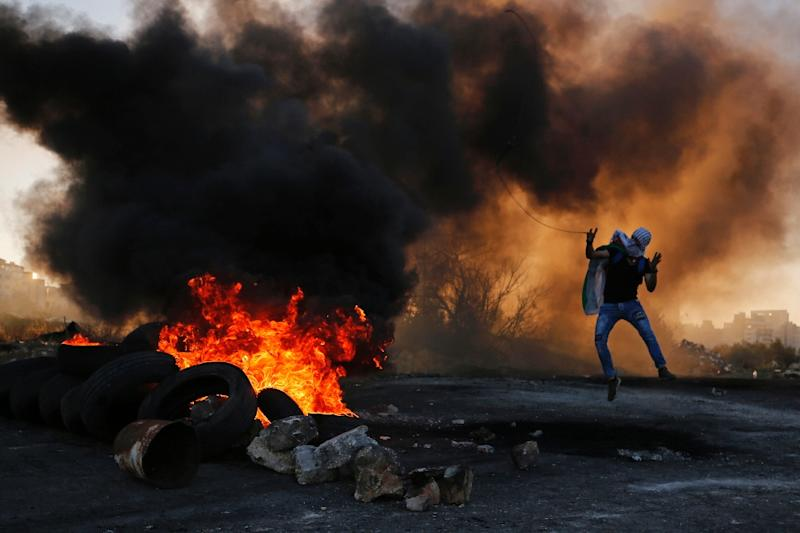 Palestinian demonstrators have clashed repeatedly with Israeli troops raiding Palestinian-controlled areas in their search for the perpetrators of a Thursday shooting that killed two soldiers (AFP Photo/ABBAS MOMANI)