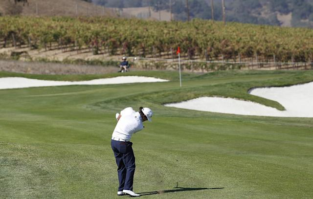 Brooks Koepka hits from the second fairway during the third round of the Frys.com Open golf tournament, Saturday, Oct. 12, 2013, in San Martin, Calif. (AP Photo/Tony Avelar)