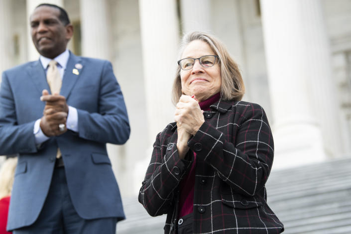 Reps. Mariannette Miller-Meeks, R-Iowa, and Burgess Owens, R-Utah, are seen during a group photo with freshmen members of the House Republican Conference on the House steps of the Capitol on January 4, 2021. (Tom Williams/CQ Roll Call via Getty Images)