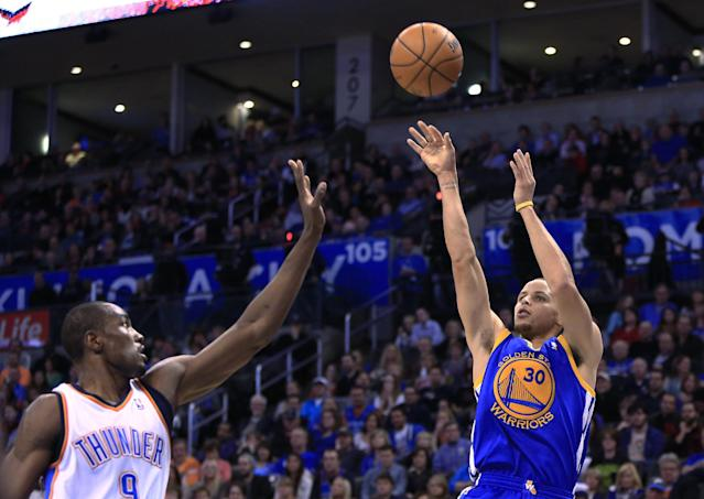 Golden State Warriors guard Stephen Curry (30) shoots as Oklahoma City Thunder forward Serge Ibaka defends during the second quarter of an NBA basketball game Friday, Jan. 17, 2014, in Oklahoma City. (AP Photo/Alonzo Adams)