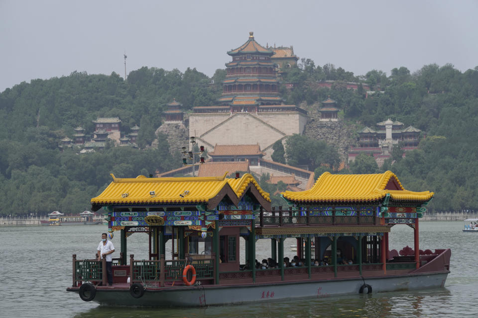 A ferry transports tourists visiting the Summer Palace in Beijing on Aug. 3, 2021. Strict virus control measures have allowed China to return to relatively normal life. The number of tourists visiting Beijing in June and July tripled compared to the same period last year, while revenue quadrupled, according to Trip.com, China's largest online travel booking platform. (AP Photo/Ng Han Guan)