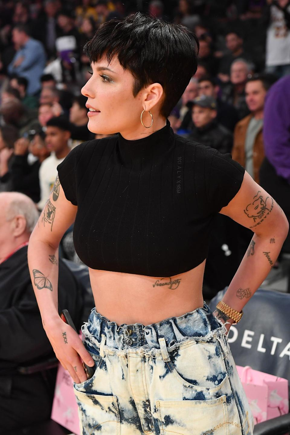 "<p>There's a large butterfly tattoo on Halsey's left forearm because, ""I just think they have a cool power,"" <a href=""https://www.marieclaire.com/celebrity/a22129283/halsey-august-2018-cover/"" class=""link rapid-noclick-resp"" rel=""nofollow noopener"" target=""_blank"" data-ylk=""slk:she told Marie Claire"">she told <strong>Marie Claire</strong></a>.</p>"
