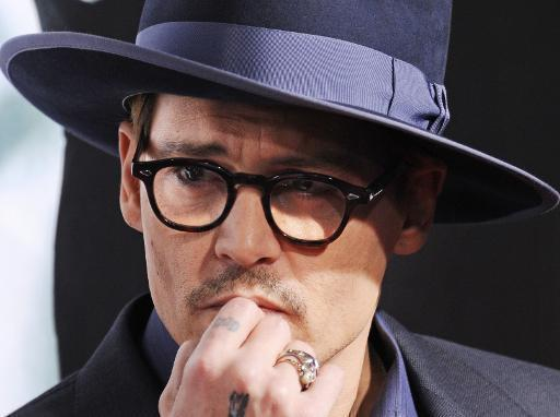Depp storms off Pirates set in pursuit of wife: report