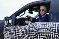 President Joe Biden stops to talk to the media as he drives a Ford F-150 Lightning truck at Ford Dearborn Development Center, Tuesday, May 18, 2021, in Dearborn, Mich. (AP Photo/Evan Vucci)