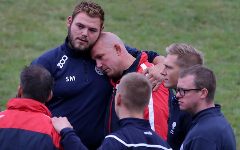 Players and club officials following a minute's silence at East Grinstead Rugby Club - Gareth Fuller/PA