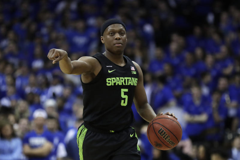 Michigan State guard Cassius Winston directs his team against Seton Hall during the first half of an NCAA college basketball game Thursday, Nov. 14, 2019, in Newark, N.J. (AP Photo/Adam Hunger)