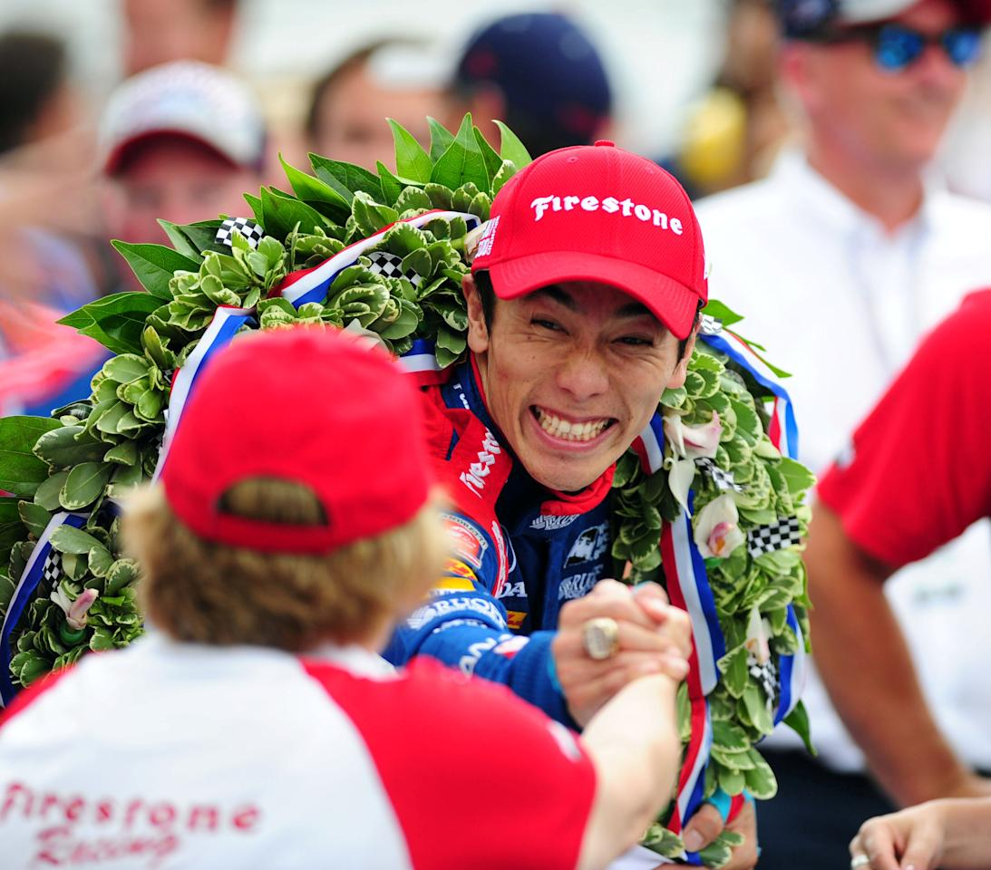 May 28, 2017; Indianapolis, IN, USA; Verizon Indycar driver Takuma Sato celebrates winning the 101st Running of the Indianapolis 500 at Indianapolis Motor Speedway. Mandatory Credit: Thomas J. Russo-USA TODAY Sports     TPX IMAGES OF THE DAY