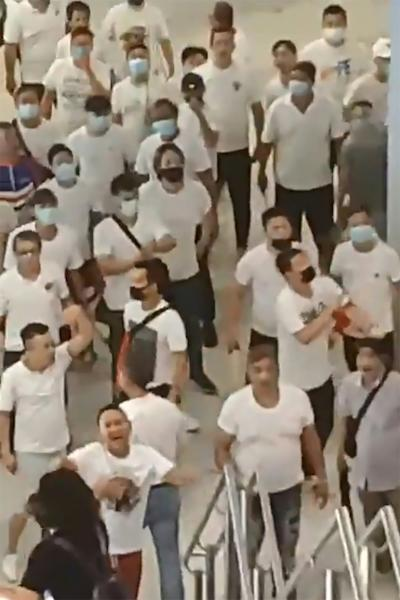 Last Sunday a gang of men in white t-shirts, armed with poles and batons, set upon Hong Kong's anti-government protesters and bystanders in Yuen Long (AFP Photo/Handout)