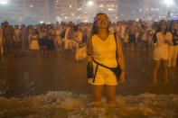 People watch the fireworks exploding over Copacabana Beach during the New Year's celebrations, in Rio de Janeiro, Brazil, Wednesday, Jan. 1, 2020. (AP Photo/Bruna Prado)