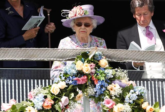 Horse Racing - Derby Festival - Epsom Downs Racecourse, Epsom, Britain - June 2, 2018 Britain's Queen Elizabeth looks on during Derby Festival REUTERS/Peter Nicholls