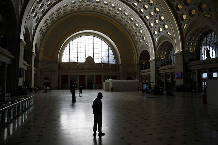 People walk in Union Station's Main Hall in Washington, D.C., on Monday.