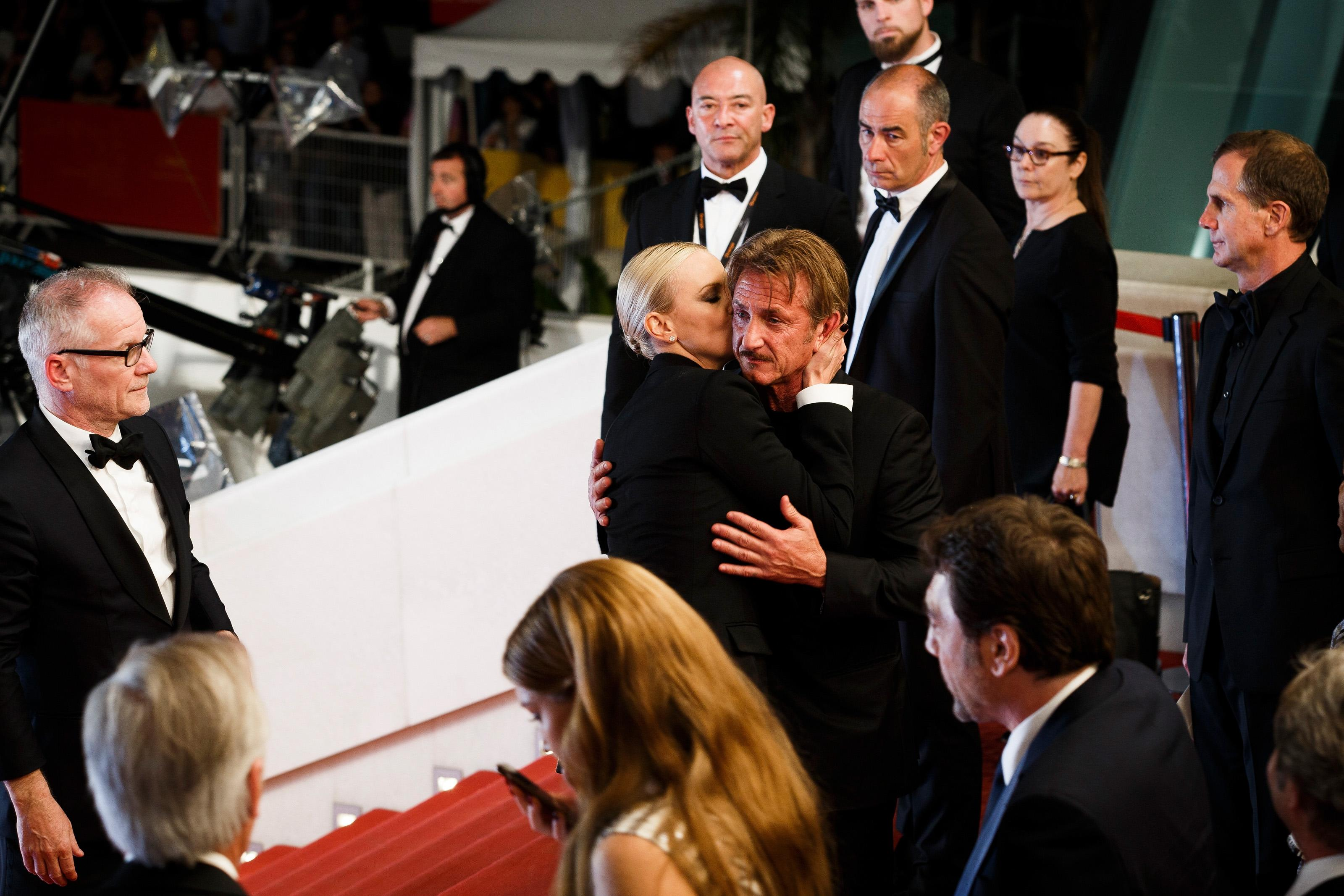"CANNES, FRANCE - MAY 20: Sean Penn and Charlize Theron embrace each other as they leave the screening of ""The Last Face"" at the annual 69th Cannes Film Festival at Palais des Festivals on May 20, 2016 in Cannes, France. (Photo by Tristan Fewings/Getty Images)"