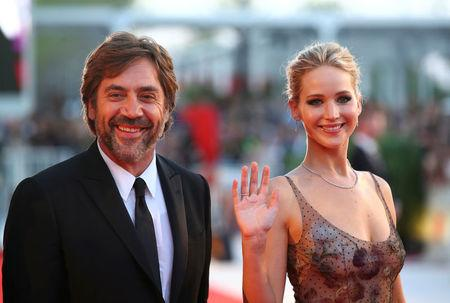 "FILE PHOTO: Actors Jennifer Lawrence (R) and Javier Bardem pose during a red carpet for the movie ""Mother!"" at the 74th Venice Film Festival in Venice, Italy on September 5, 2017. REUTERS/Alessandro Bianchi/File Photo"