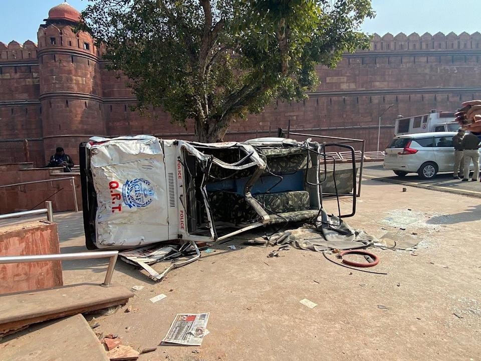 An upturned vehicle at the Red Fort complex.