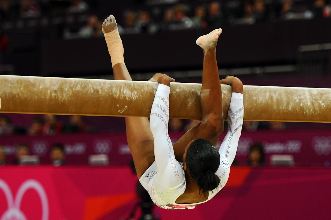 LONDON, ENGLAND - AUGUST 07:  Gabrielle Douglas of the United States falls off the beam during the Artistic Gymnastics Women's Beam final on Day 11 of the London 2012 Olympic Games at North Greenwich Arena on August 7, 2012 in London, England.  (Photo by Michael Regan/Getty Images)