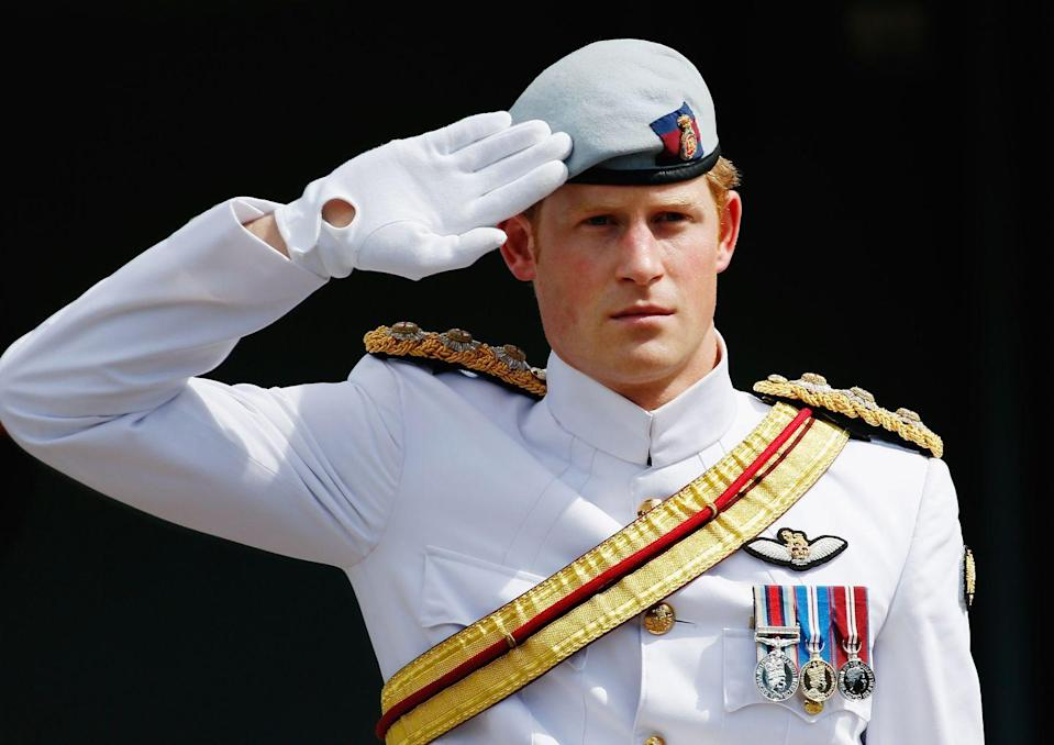 <p>The prince salutes at the International Fleet Review in Sydney, Australia. </p>
