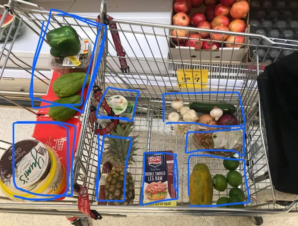 A photo posted by a Coles shopper showing off her handy hack to track her spending. Each $10 worth of groceries in her trolley is surrounded by a blue rectangle.