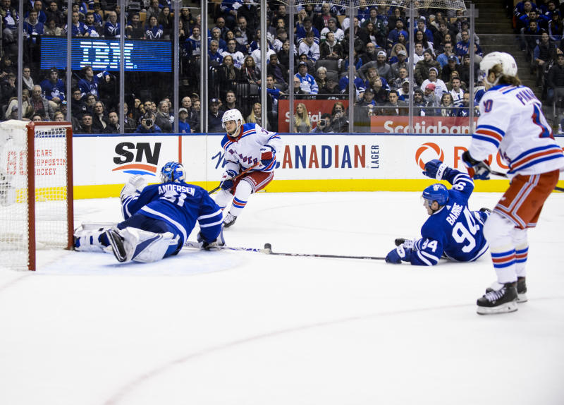 TORONTO, ON - DECEMBER 28: Tony DeAngelo #77 of the New York Rangers scores the game winning goal against Frederik Andersen #31 of the Toronto Maple Leafs in overtime at the Scotiabank Arena on December 28, 2019 in Toronto, Ontario, Canada. (Photo by Andrew Lahodynskyj/NHLI via Getty Images)