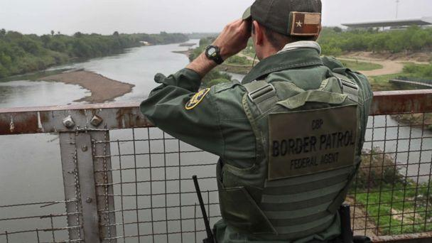 PHOTO: A U.S. Border Patrol agent scans the U.S.-Mexico border while on a bridge over the Rio Grande, March 13, 2017, in Roma, Texas (John Moore/Getty Images)