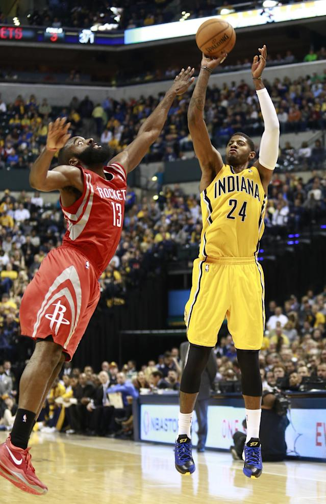 Indiana Pacers forward Paul George (24) shoots while guarded by Houston Rockets guard James Harden in the second half of an NBA basketball game in Indianapolis, Friday, Dec. 20, 2013. (AP Photo/R Brent Smith)