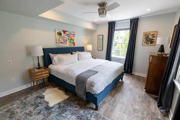 This bedroom at 510 Queens has a painting over the bed by Charlotte artist Jerri Tuck in collaboration with Micah Gaugh.