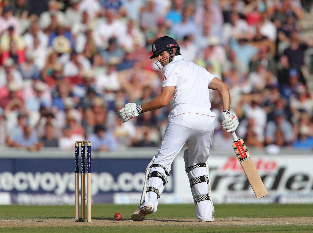 England batsman Alastair Cook watches the ball as it almost hits the wicket off Australia's bowler Shane Watson during day two of the Third Investec Ashes test match at Old Trafford Cricket Ground, Manchester.