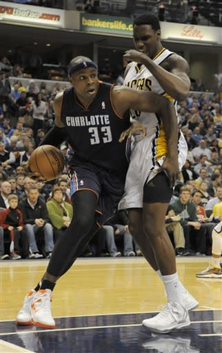 Charlotte Bobcats center Brendan Haywood (33) drives around Indiana Pacers center Ian Mahinmi, right, in the first half of an NBA basketball game in Indianapolis, Wednesday, Feb. 13, 2013. (AP Photo/ Alan Petersime)