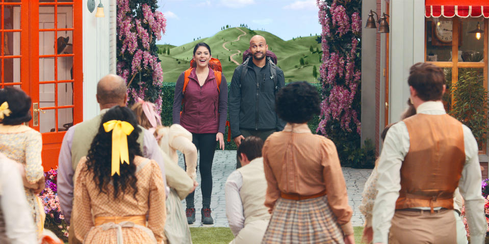 """This image released by Apple TV+ shows Cecily Stron, background left, and Keegan-Michael Key in a scene from """"Schmigadoon!,"""" premiering Friday. (Apple TV+ via AP)"""