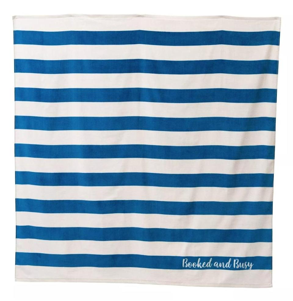 """<p>Lose yourself in a gripping beach read on this striped <span>Disney Princess X POPSUGAR Belle Beach Towel</span> ($20) that reads """"Booked and Busy.""""</p>"""