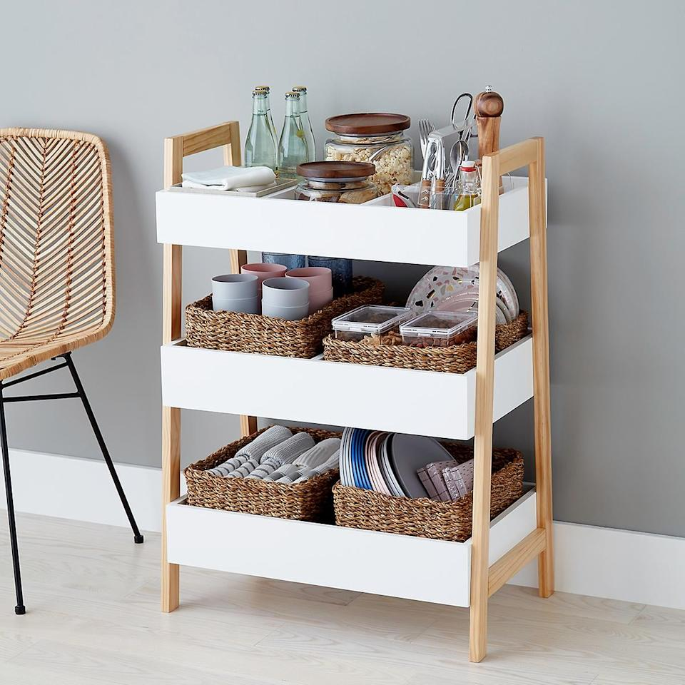 "<p>This <a href=""https://www.popsugar.com/buy/White-Multipurpose-3-Tier-Shelf-484278?p_name=White%20Multipurpose%203-Tier%20Shelf&retailer=containerstore.com&pid=484278&price=75&evar1=casa%3Aus&evar9=46542507&evar98=https%3A%2F%2Fwww.popsugar.com%2Fhome%2Fphoto-gallery%2F46542507%2Fimage%2F46543032%2FWhite-Multipurpose-3-Tier-Shelf&list1=shopping%2Corganizing%2Corganization%2Csmall%20space%20living%2Chome%20organization%2Chome%20shopping&prop13=api&pdata=1"" rel=""nofollow"" data-shoppable-link=""1"" target=""_blank"" class=""ga-track"" data-ga-category=""Related"" data-ga-label=""https://www.containerstore.com/s/whats-new/white-multi-purpose-3-tier-shelf/1d?productId=11010647"" data-ga-action=""In-Line Links"">White Multipurpose 3-Tier Shelf</a> ($75, originally $100) is both useful and cute.</p>"