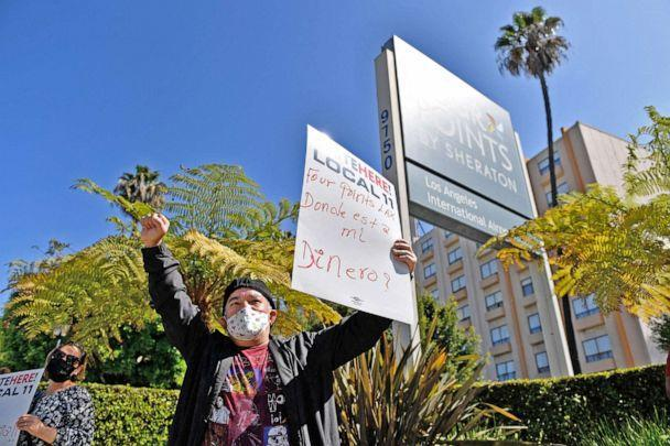 PHOTO: Laid-off employees and workers with Unite Here 11 protest outside the closed Four Points by Sheraton LAX hotel calling for an investigation by the US Small Business Administration (SBA) into the use of PPP loan funds in Los Angeles, April 7, 2021. (Patrick T. Fallon/AFP via Getty Images, FILE.)