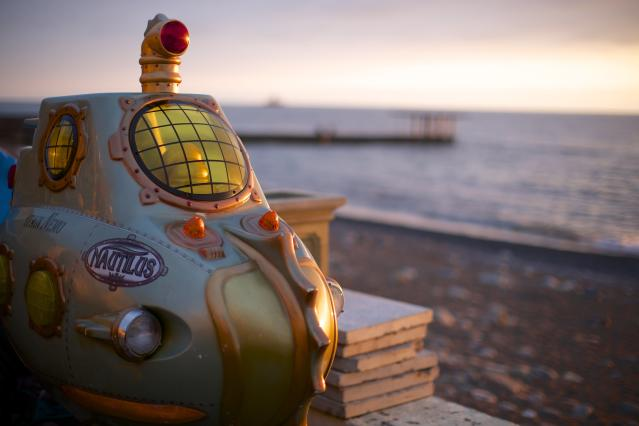 In this photo taken on Thursday, Nov. 28, 2013, a submarine from an amusement arcade is on the beach in central Sochi, Russia. As the Winter Games are getting closer, many Sochi residents are complaining that their living conditions only got worse and that authorities are deaf to their grievances. (AP Photo/Alexander Zemlianichenko)