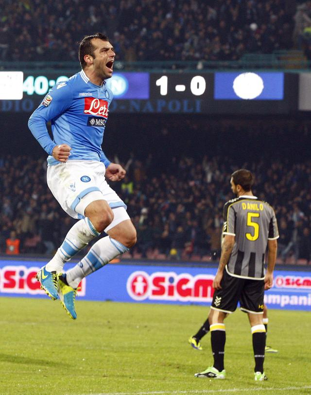 Napoli's Goran Pandev (L) celebrates after scoring his second goal against Udinese during their Italian Serie A soccer match at San Paolo stadium in Naples December 7, 2013. REUTERS/Ciro De Luca (ITALY - Tags: SPORT SOCCER)
