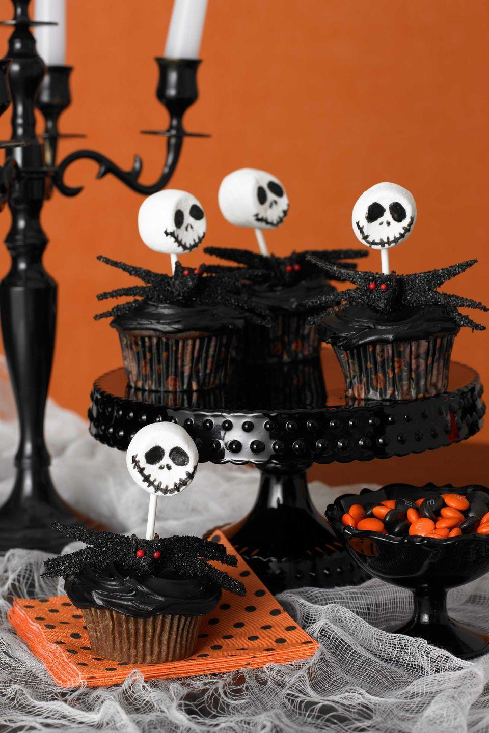 """<p>All it takes to make these skeletal creatures is marshmallows, devil's food cake, and whatever decorations appeal to you!</p><p><a href=""""https://www.womansday.com/food-recipes/food-drinks/recipes/a9352/skeleton-cupcakes-121387/"""" rel=""""nofollow noopener"""" target=""""_blank"""" data-ylk=""""slk:Get the Creepy Skeleton Cupcakes recipe."""" class=""""link rapid-noclick-resp""""><em>Get the Creepy Skeleton Cupcakes recipe.</em></a></p>"""