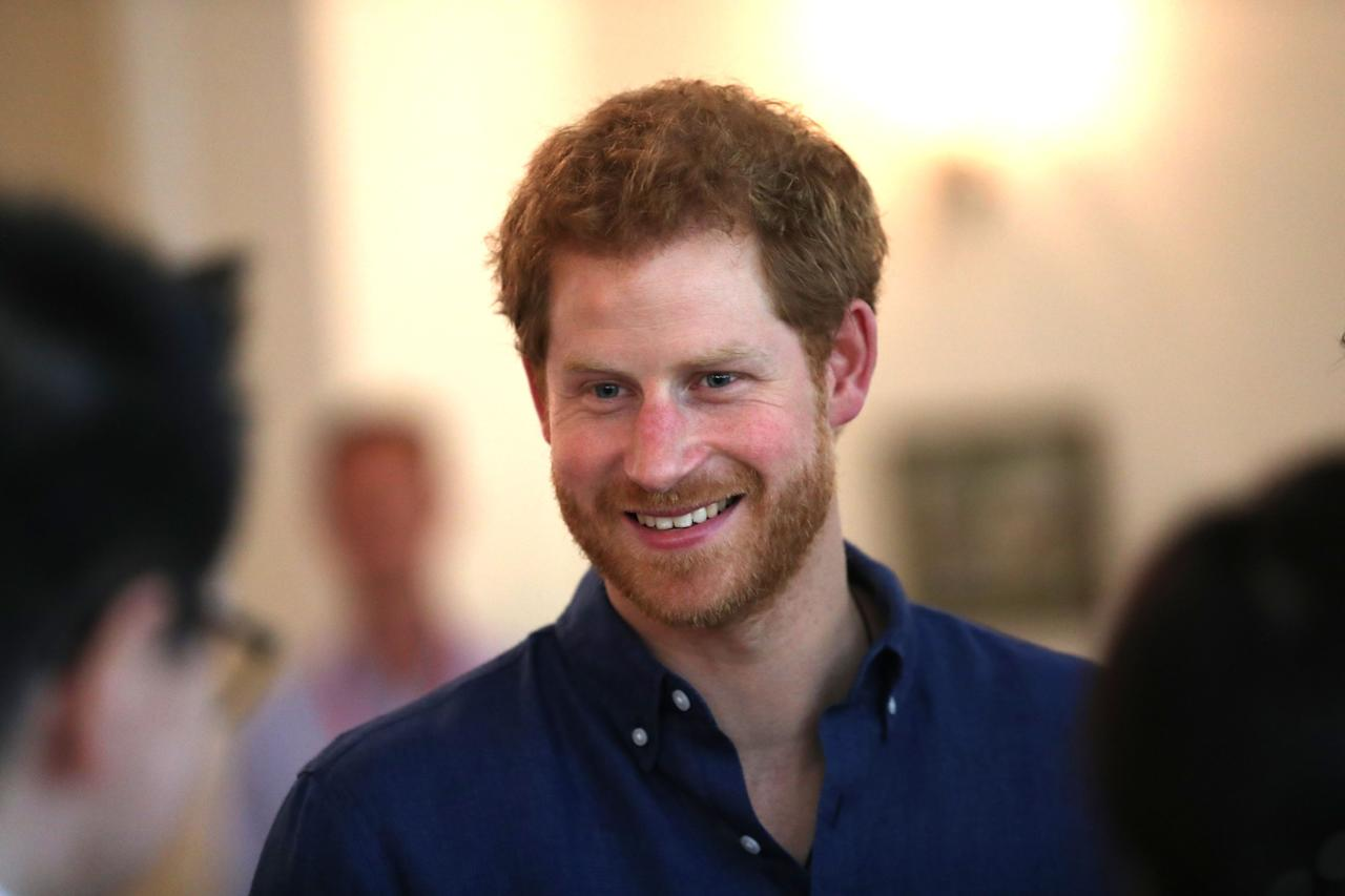 Prince Harry attends an Action for Aids reception at Eden Hall in Singapore in June 2017.