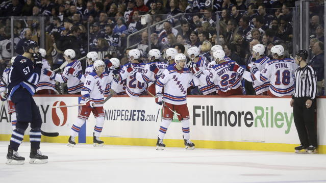 New York Rangers right wing Pavel Buchnevich (89) celebrates at the bench after scoring against the Winnipeg Jets during the second period of an NHL hockey game Tuesday, Feb. 12, 2019, in Winnipeg, Manitoba. (Trevor Hagan/The Canadian Press via AP)