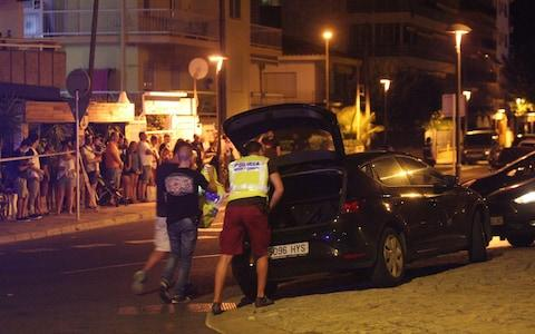 Spanish Policemen inspect a car in Cambrils - Credit: EPA