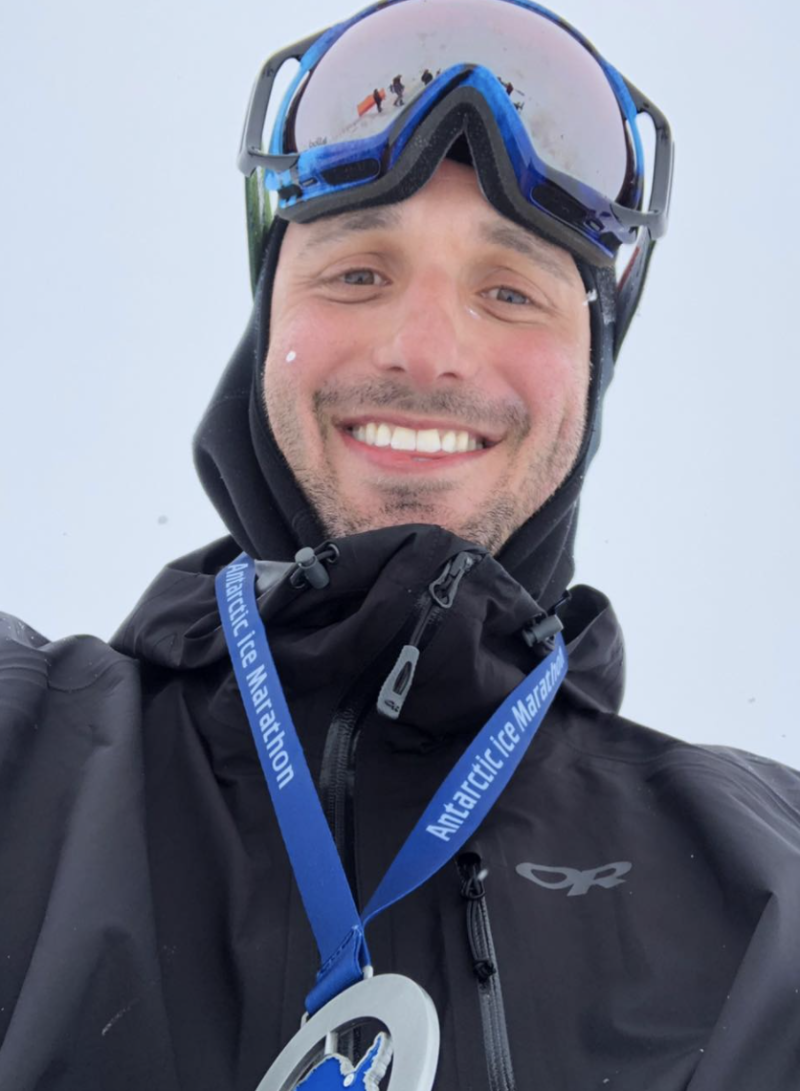 Tommy Little takes a selfie after completing the Antarctic Ice Marathon in 2018