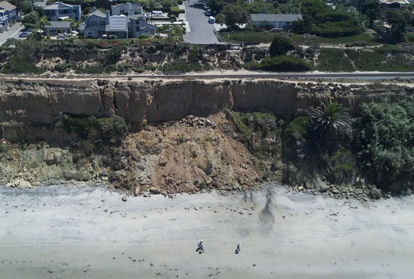 Local officials are ramping up awareness of the danger present at the beach for people who relax on the beach underneath unstable cliffs. Walkers kept their distance from the eroding cliffs in Del Mar on Thursday, August 8, 2019.