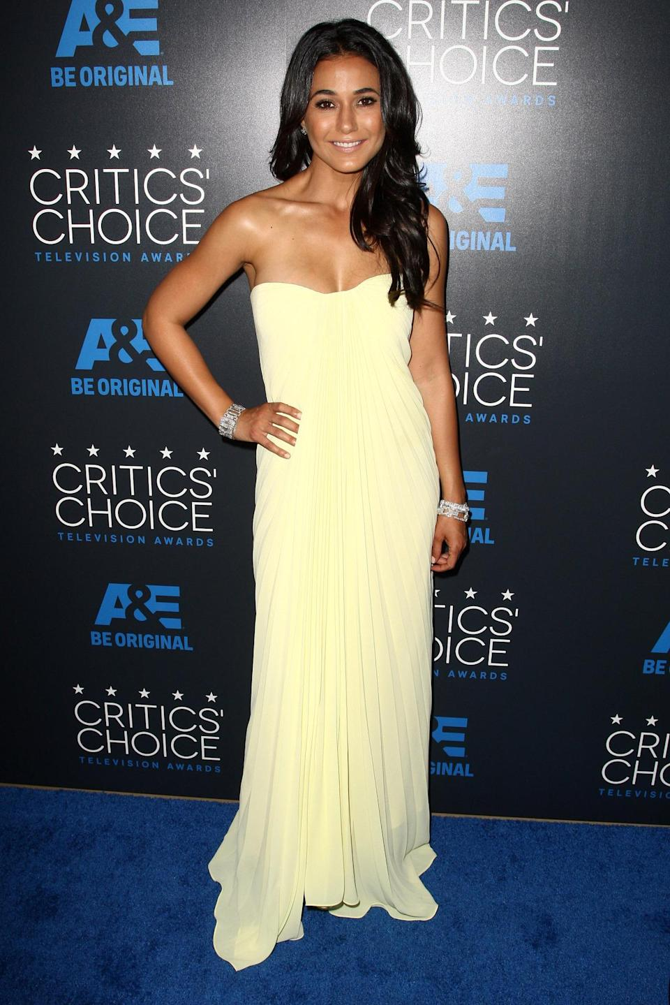 With a tan glow, Emmanuelle Chriqui was the quintessential California girl in a pale yellow floor-length gown.