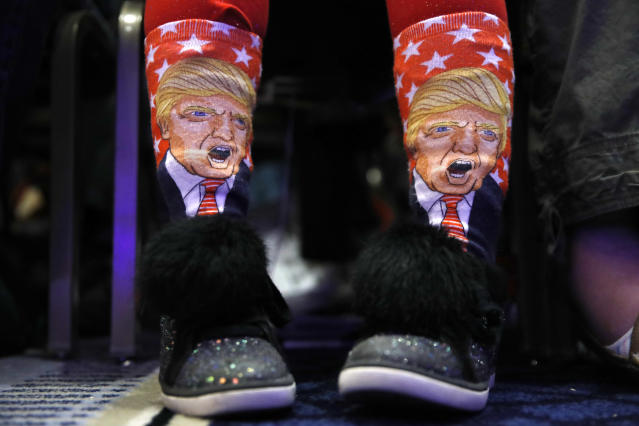 <p>Millie March, 12, of Fairfax, Va., wears socks featuring President Donald Trump while awaiting his speech to the Conservative Political Action Conference (CPAC), at National Harbor, Md., Friday, Feb. 23, 2018. (Photo: Jacquelyn Martin/AP) </p>