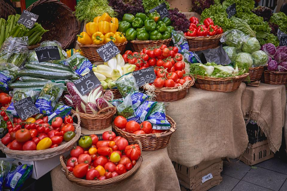 Green groceries including tomatoes, lettuce, and peppers on sale in Borough Market, London. Photo: Getty