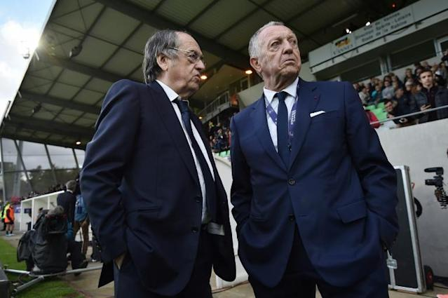 French Football Federation president Noel Le Graet (left) is not happy Lyon president Jean-Michel Aulas (right) (AFP Photo/JEAN-SEBASTIEN EVRARD)