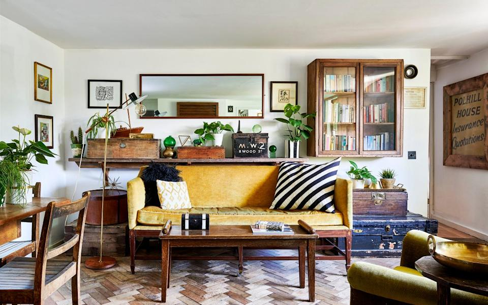 Mimi furnished her home with pieces she brought from her old house and others she picked up from antique fairs and auctions, such as her £200 sofa - Ingrid Rasmussen
