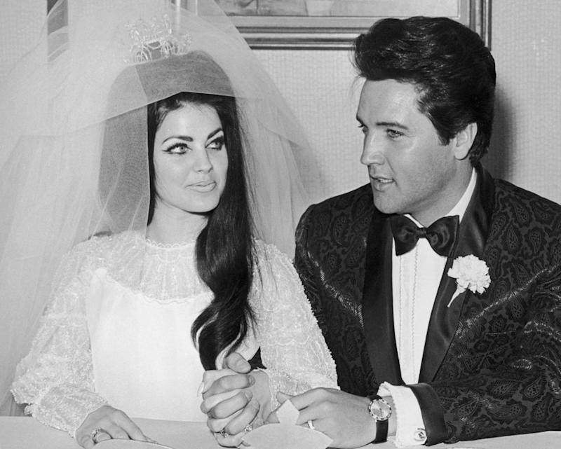 Priscilla and Elvis Presley at their wedding | Hulton Archive/Getty