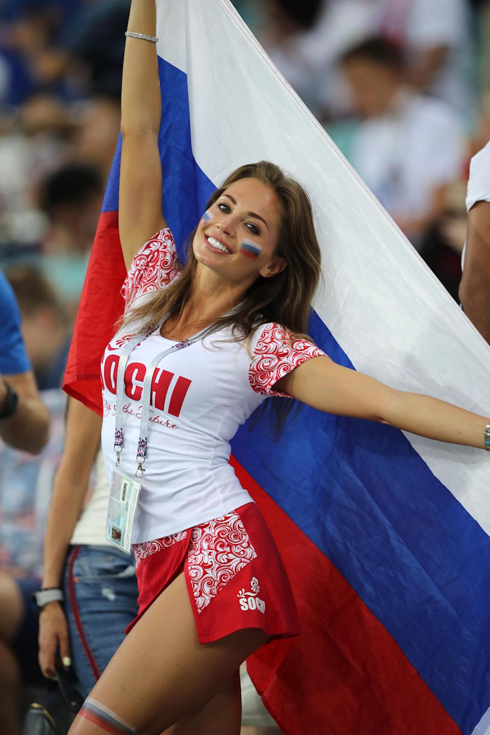 <p>A female fan of Russia looks on prior to the 2018 FIFA World Cup Russia Quarter Final match between Russia and Croatia at Fisht Stadium on July 7, 2018 in Sochi, Russia. (Photo by Matthew Ashton – AMA/Getty Images) </p>